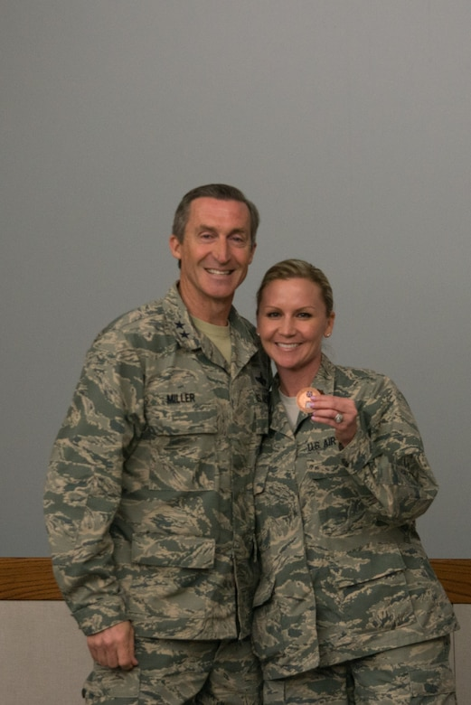 "Maj. Sabrina Ura received a coin from Tenth Air Force Commander, Maj. Gen. Ronald B. ""Bruce"" Miller in recognition of her contribution to the conference."