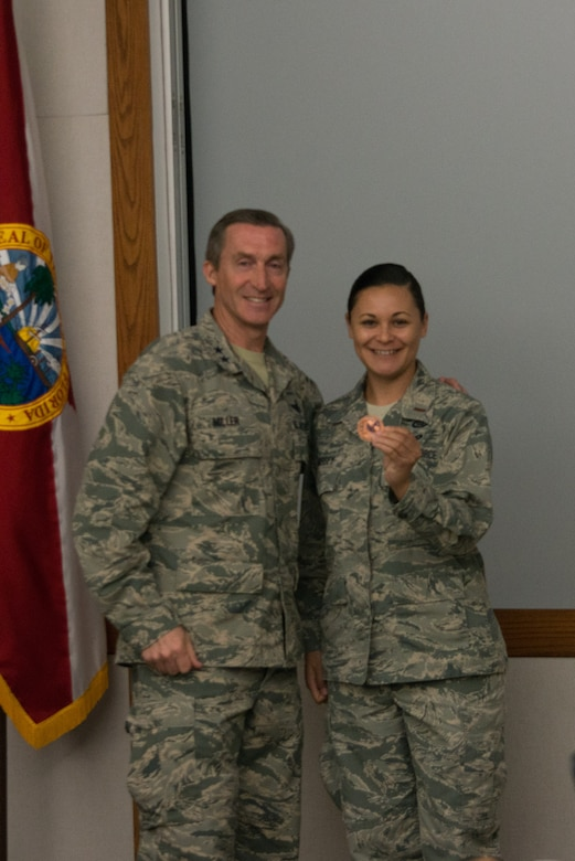 "Second Lt. Kaitlin Massey received a coin from Tenth Air Force Commander, Maj. Gen. Ronald B. ""Bruce"" Miller in recognition of her contribution to the conference."