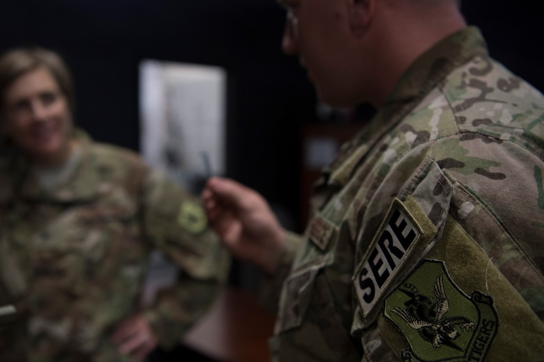 Tech. Sgt. Travis, 347th Operations Support Squadron NCO in charge of Survival, Evasion, Resistance and Escape (SERE) training, briefs Col. Jennifer Short, 23d Wing commander, on training tools and techniques during a 347th Rescue Group immersion, Feb. 26, 2018, at Moody Air Force Base, Ga. During the immersion, 23d WG leadership was given an in-depth briefing and demonstration of how SERE specialists and Independent Duty Medical Technicians ensure Moody's aircrew have the skills to survive in the worst of situations. (U.S. Air Force photo by Senior Airman Daniel Snider)