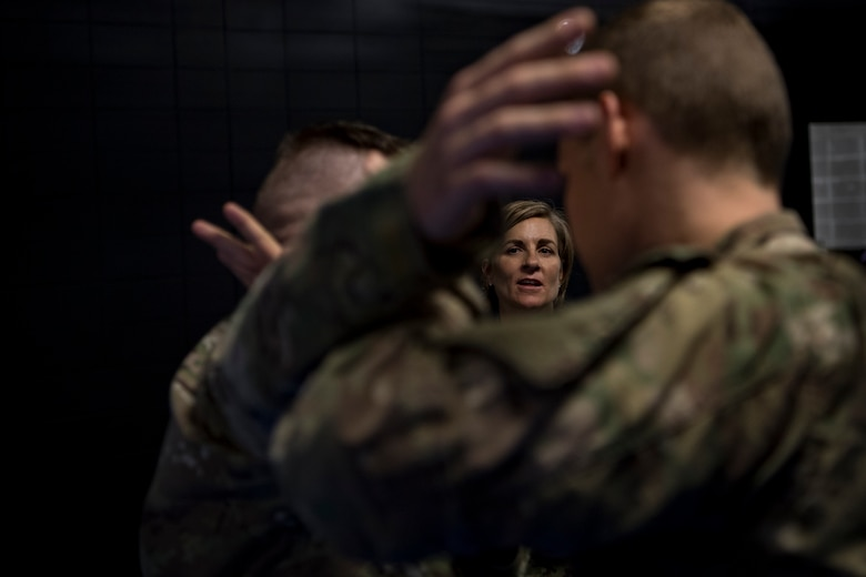 Col. Jennifer Short, 23d Wing commander, watches as Airmen from the 347th Operations Support Squadron demonstrate combative techniques used in Survival, Evasion, Resistance and Escape (SERE) training during a 347th Rescue Group immersion, Feb. 26, 2018, at Moody Air Force Base, Ga. During the immersion, 23d WG leadership was given an in-depth briefing and demonstration of how SERE specialists and Independent Duty Medical Technicians ensure Moody's aircrew have the skills to survive in the worst of situations. (U.S. Air Force photo by Senior Airman Daniel Snider)