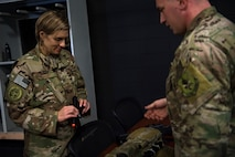Tech. Sgt. Travis, right, 347th Operations Support Squadron NCO in charge of Survival, Evasion, Resistance and Escape (SERE) training, briefs Col. Jennifer Short, 23d Wing commander, on training tools and techniques during a 347th Rescue Group immersion, Feb. 26, 2018, at Moody Air Force Base, Ga. During the immersion, 23d WG leadership was given an in-depth briefing and demonstration of how SERE specialists and Independent Duty Medical Technicians ensure Moody's aircrew have the skills to survive in the worst of situations. (U.S. Air Force photo by Senior Airman Daniel Snider)
