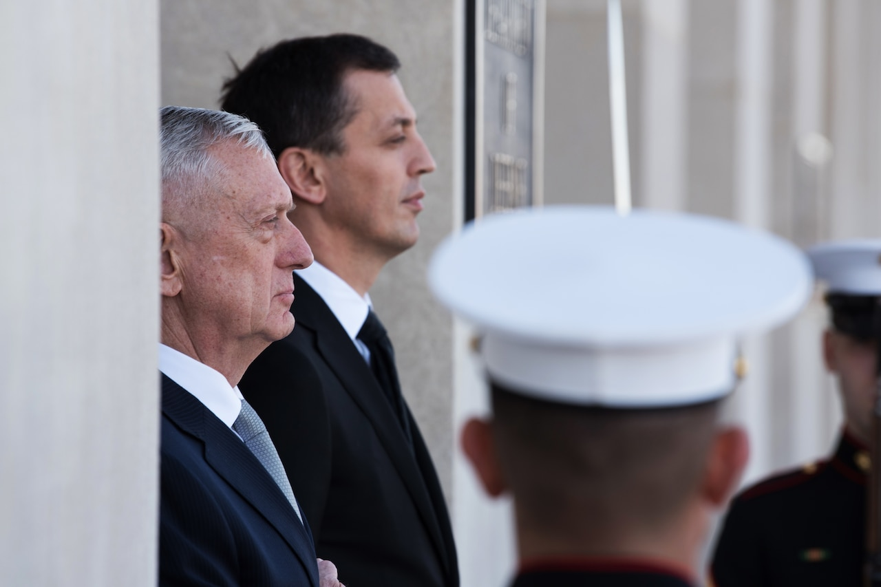 Defense Secretary James N. Mattis stands next to the Montenegrin defense minister.