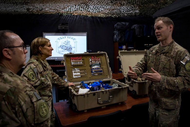 Staff Sgt. Cory Newby, 347th Operations Support Squadron independent-duty medical technician, right, briefs Col. Jennifer Short, 23d Wing commander, and Chief Master Sgt. Jarrod Sebastian, 23d Wing command chief, on training tools and techniques used during Tactical Combat Casualty Care courses, during a 347th Rescue Group immersion, Feb. 26, 2018, at Moody Air Force Base, Ga. During the immersion, 23d WG leadership was given an in-depth briefing and demonstration of how SERE specialists and Independent Duty Medical Technicians ensure Moody's aircrew have the skills to survive in the worst of situations. (U.S. Air Force photo by Senior Airman Daniel Snider)
