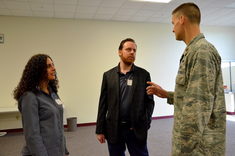 Maj. Kelly Greiner, program manager for Nuclear ISR Field Systems and Industry Day's event coordinator, discusses network opportunities with Seni Aguiar (left), and Michael Ballard at Industry Day Feb. 9, 2018, hosted by the Air Force Technical Applications Center, Patrick AFB, Fla.  Ballard, president and founder of TechRev, brought Aguiar, his operations manager, to the event to learn more about partnerships with the Department of Defense's sole nuclear treaty monitoring center.  (U.S. Air Force photo by Susan A. Romano)