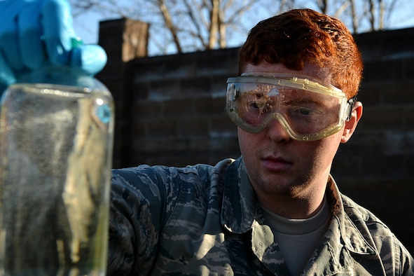 U.S. Air Force Airman 1st Class Zachary Hupp, 20th Logistics Readiness Squadron fuels laboratory technician, pulls a fuel sample to take back to the lab for testing at Shaw Air Force Base, S.C., Feb. 23, 2018.