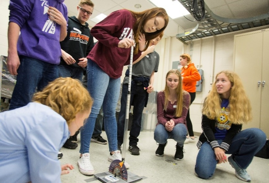 Air Force Institute of Technology Demo Days participants prepare to launch a small rocket, after setting trajectory and power, in a competition for distance and accuracy Feb. 21, 2018 on Wright-Patterson Air Force Base, Ohio. Groups of local high school and middle school students moved among stations being exposed to subjects such as robotics, civil engineering, magnetics and electricity. (U.S. Air Force photo by R.J. Oriez)