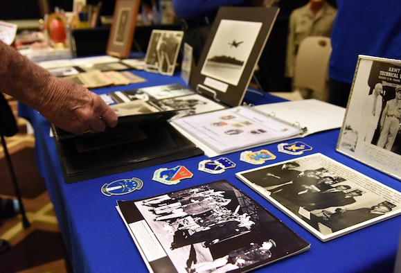 Pat Byrd, Biloxi resident, views Keesler Air Force Base memorabilia during the Gulf Coast Historical and Cultural Exposition at the Biloxi Civic Center Feb. 23, 2018, in Biloxi, Mississippi. The event, which consisted of historical and cultural groups displaying the rich and diverse history and culture of the Mississippi Gulf Coast, also showcased both Keesler AFB and Air Force history. (U.S. Air Force photo by Kemberly Groue)