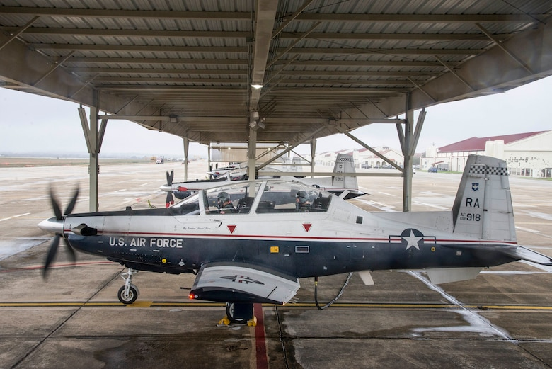 U.S. Air Force Maj. Gen. Patrick Doherty, 19th Air Force commander, and Maj. Lincoln Olsen, T-6 instructor pilot, conduct a T-6 Texan II safety check before conducting an operational demonstration at Joint Base San Antonio-Randolph, Texas, Feb. 21, 2018. Doherty was on the flightline getting test data first-hand during the command-wide T-6 operational pause. (U.S. Air Force photo by Sean Worrell)