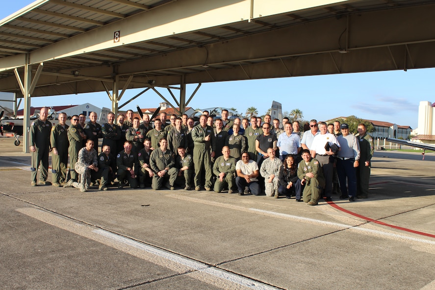 U.S. Air Force Maj. Gen. Patrick Doherty, 19th Air Force commander, and Air Education and Training Command pilots, maintainers and flight surgeons, plus NASA personnel gather for a photograph during the command's collection and analysis of operational flight test data at Joint Base San Antonio-Randolph.  The T-6 operational pause which began Feb. 1 was lifted Feb. 27.  Following the incidents, a team including experts from the Air Force, Navy, NASA, and medical specialties, came together to aggressively capture and analyze data from the pilots who had experienced physiological events and the aircraft. Collaboration with Navy officials allowed 19th Air Force officials to gain insights and lessons learned from similar events in the T-45 Goshawk. (Courtesy Photo)