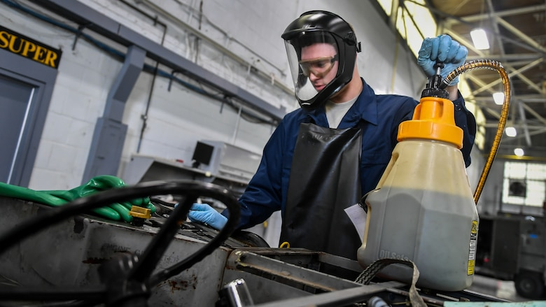 Airman 1st Class Jared Fayard, 2nd Maintenance Squadron aerospace ground equipment technician, adds new motor oil to a bomb loader vehicle at Barksdale Air Force Base, La., Feb. 27, 2018. Fayard changed the engine oil as part of an annual safety inspection conducted on all bomb loading vehicles.