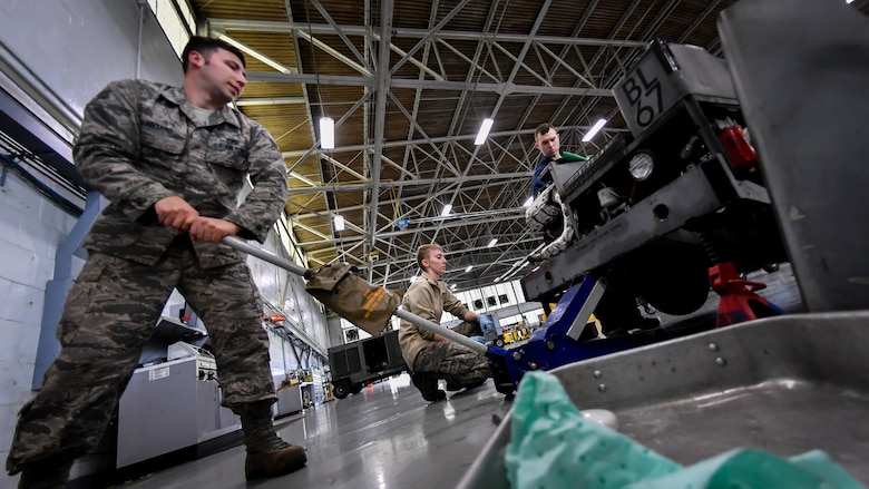 Aerospace ground equipment technicians lift a bomb loader vehicle prior to a tire change at Barksdale Air Force Base, La., Feb. 27, 2018. The annual safety inspection also allowed Airmen to inspect tires, gaskets and others parts of the vehicle.