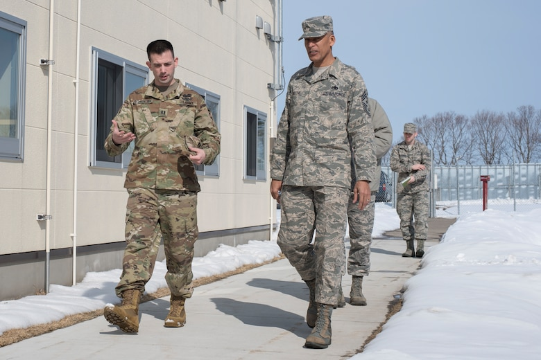 "U.S. Army Capt. Lee Schroeder, left, the Delta Detachment, 1st Space Company, Joint Tactic Army Ground Station commander, walks with U.S. Air Force Chief Master Sgt. Terrence A. Greene, right, the United States Forces Japan and Fifth Air Force command chief, during his visit to the JTAGS facility at Misawa Air Base, Japan, Feb. 23, 2018. Greene's tour included meeting with Team Misawa and Japan Air Self-Defense Force members in order to better understand the capabilities and responsibilities each unit contributes to the ""fight tonight"" mentality. (U.S. Air Force photo by Airman 1st Class Collette Brooks)"