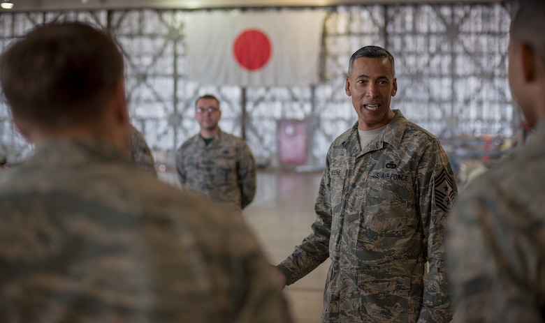 U.S. Air Force Chief Master Sgt. Terrence A. Greene, the United States Forces Japan and Fifth Air Force command chief, speaks with 35th Maintenance Group Airmen at Misawa Air Base, Japan, Feb. 23, 2018. Greene explained the benefits of facing adversities with perseverance and growth. (U.S. Air Force photo by Airman 1st Class Collette Brooks)