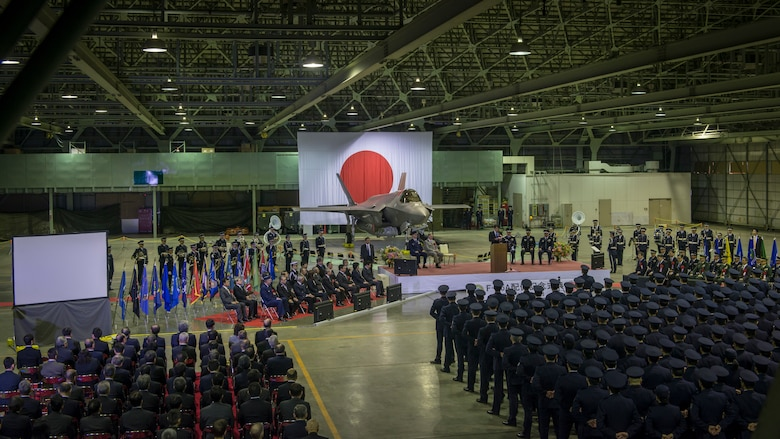 Senior leaders of Japan's Ministry of Defense, U.S. Forces Japan, Pacific Air Forces and Lockheed Martin gather in a Japan Air Self-Defense Force hangar at Misawa Air Base, Japan, for the commemorative ceremony welcoming the first operational F-35A Lightning II to JASDF's 3rd Air Wing, Feb. 24, 2018. The F-35A is the second assembled at Mitsubishi's facility in Nagoya, Japan. Regional leaders from Misawa City and Aomori Prefecture also attended the ceremony. (U.S. Air Force photo by Tech. Sgt. Benjamin W. Stratton)