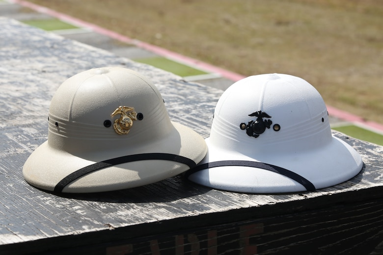 CAMP SCHWAB, OKINAWA, Japan – Two range coach hard hats sit on an ammunition table on rifle range Feb. 14 aboard Camp Schwab, Okinawa, Japan.