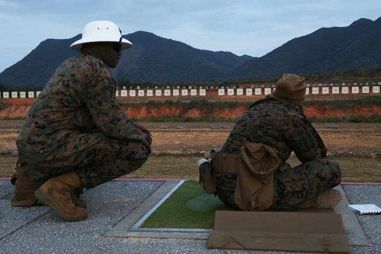 CAMP SCHWAB, OKINAWA, Japan – A range coach watches as a shooter fires on the rifle range Feb. 14 aboard Camp Schwab, Okinawa, Japan.