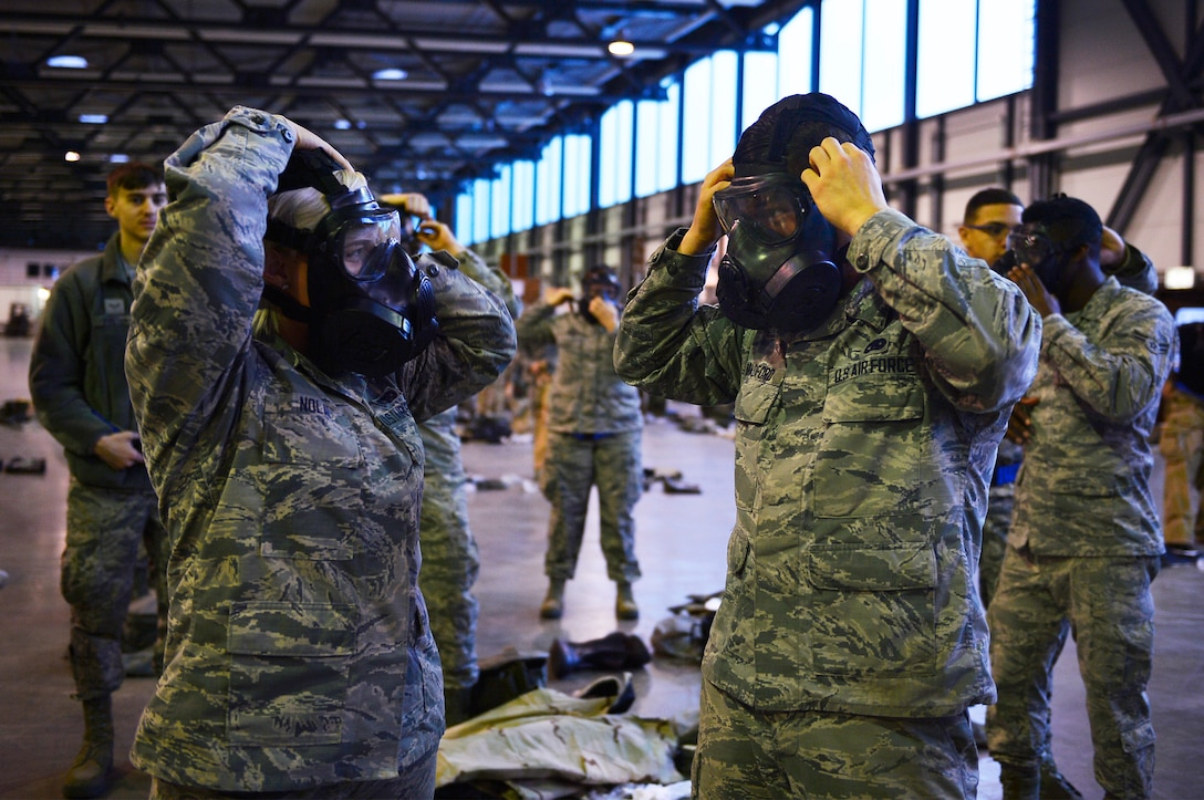 521st Air Mobility Operations Wing Airmen don gas masks during a chemical, biological, radiological, and nuclear training session on Ramstein Air Base, Germany, Feb. 16, 2018. The 721st Air Mobility Operations Group conducted a training day which included CBRN skills, self-aid buddy care, and risk management. (U.S. Air Force photo by Senior Airman Joshua Magbanua)