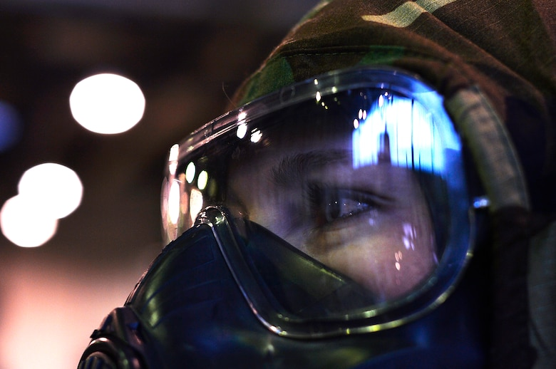 U.S. Air Force Senior Airman Heather Sempsrott, 721st Aerial Port Squadron special handling technician, wears protective gear during a training day on Ramstein Air Base, Germany, Feb. 16, 2018. The 721st Air Mobility Operations Group serves as a hub for strategic airlift transiting in and throughout three geographic combatant commands. (U.S. Air Force photo by Senior Airman Joshua Magbanua)