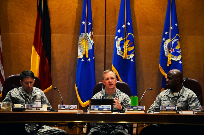 U.S. Air Force Col. Thomas Cooper, 521st Air Mobility Operations Wing commander, addresses 521st Air Mobility Operations Wing leadership during a conference on Ramstein Air base, Germany, Feb. 21, 2018. Group and squadron commanders, superintendents and first sergeants came from various installations across Europe and Southwest Asia to discuss topics such as mission readiness, unit effectiveness, and Airmen morale and readiness. (U.S. Air Force photo by Senior Airman Joshua Magbanua)