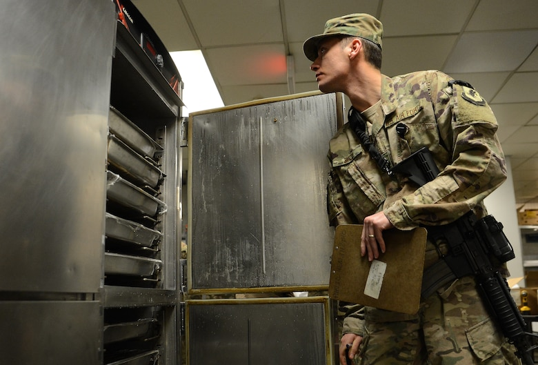 Staff Sgt. Nikola Bozic, 455th Expeditionary Medical Group public health technician, inspects a food warmer during his routine food inspection of the Grady dining facility Feb. 15, 2018 at Bagram Airfield, Afghanistan.