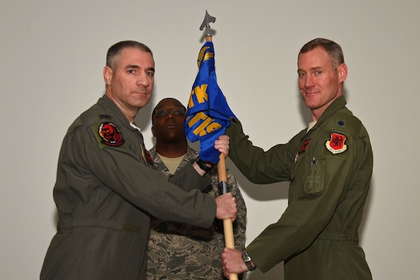 U.S. Air Force Col. Joseph, 432nd Operations Group (OG) commander, left, appoints Lt. Col. David, former 432nd OG Det. 1 commander, as commander of the 50th Attack Squadron following the squadron's activation at Shaw Air Force Base, S.C., Feb. 27, 2018.