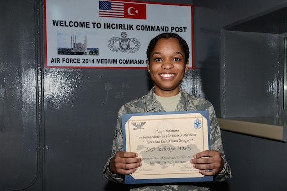 Senior Airman Melodye Mosby, 39th Air Base Wing Command Post senior emergency actions controller, accepts the deployed Larger Than Life award.