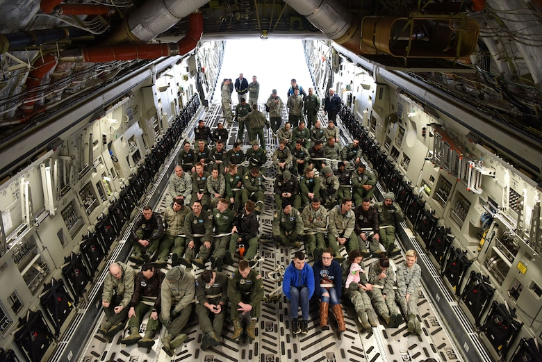 The 436th Aerial Port Squadron Passenger Terminal, the 3rd Airlift Squadron and the 9th Airlift Squadron conducted a Noncombatant Evacuation Order during a base exercise Feb. 23, 2018. Aboard a C-17 Globemaster III, crew members secure passengers in preparation for simulated evacuation during the exercise. (U.S. Air Force photo by Airman 1st Class Zoe M. Wockenfuss)