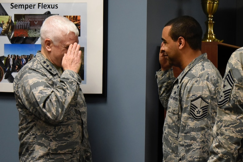 Lt. Gen. L. Scott Rice, the Director of the Air National Guard, Master Sgt. Dallas Perry, 235th Civil Engineering Flight program analyst, salutes Lt. Gen. L. Scott Rice, the Director of the Air National Guard, after being coined February 10, 2018 at Warfield Air National Guard Base, Middle River, Md.