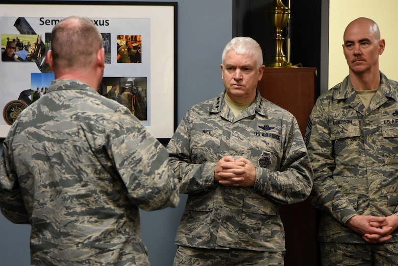 Lt. Gen. L. Scott Rice, the Director of the Air National Guard, and Command Chief Master Sgt. Ronald C. Anderson Jr., Command Chief Master Sergeant of the Air National Guard, listen to a question from a 235th Civil Engineering Flight member, February 10, 2018 while touring Warfield Air National Guard Base, Middle River, Md.