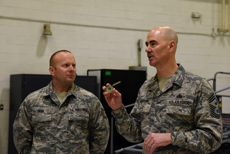 Command Chief Master Sgt. Ronald C. Anderson Jr., Command Chief Master Sergeant of the Air National Guard, gives a speech before presenting a coin to Tech. Sgt. Michael Dison, 175th Aircraft Maintenance Squadron crew chief, February 10, 2018 while touring Warfield Air National Guard Base, Middle River, Md.