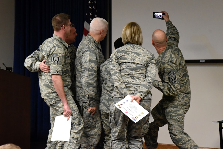 Command Chief Master Sgt. Ronald C. Anderson Jr., Command Chief Master Sergeant of the Air National Guard, takes a selfie with members of the 175th Wing Junior Enlisted Council February 10, 2018 while touring Warfield Air National Guard Base, Middle River, Md.