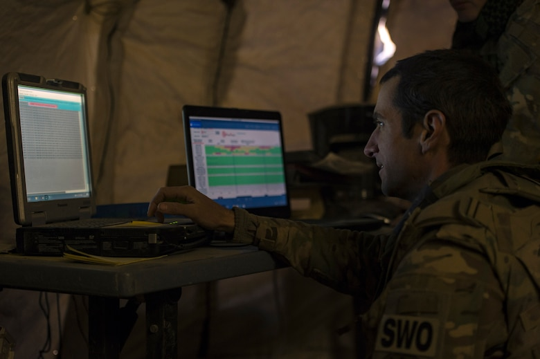 U.S. Air Force Staff Sgt. Kevin Byrne, 3d Air Support Operations Group, Detachment 3 staff weather operator, analyzes weather forecasts during pre-deployment rotation training at Ft. Irwin, California's, National Training Center, Feb. 19, 2018. During their month-long NTC rotation, Air Force weather assets from various units within the 93d Air Ground Operations Wing advised, trained and assisted Army units to exploit weather and environmental conditions as they battled mock adversaries. As the Army's sole weather support asset, the training maximized integration in a hostile environment to enhance interoperability and assure mission success. (U.S. Air Force photo Senior Airman Greg Nash)