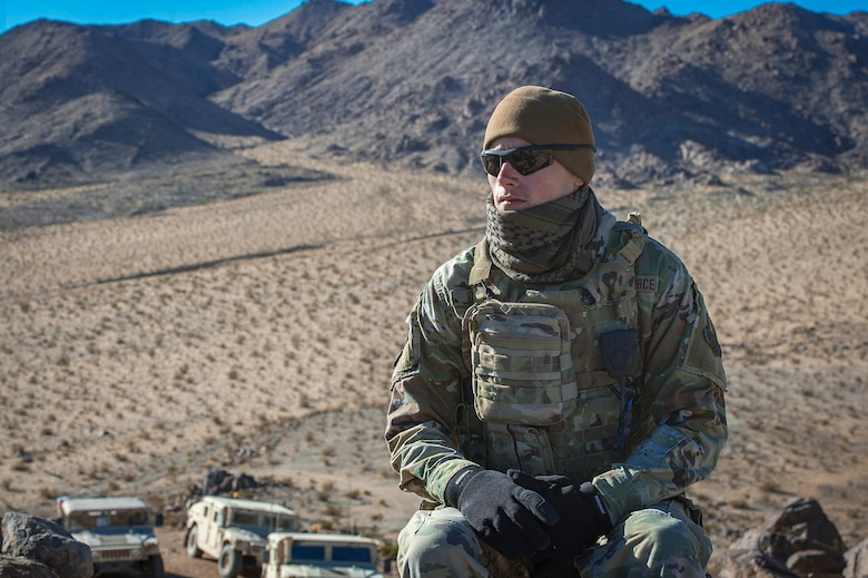 Senior Airman Dylan Olson, 11th Air Support Operations Squadron radio maintainer, embraces the cold in the Mojave Desert before helping guide F-16 Fighting Falcons through close-air support training at Ft. Irwin, Calif., during a National Training Center pre-deployment rotation, Feb. 20, 2018. Using Army support weather forecasters specialized meteorology skills, Air Force Tactical Air Control Parties helped maneuver aircraft through harsh winds in a safe manner. (U.S. Air Force photo by Senior Airman Greg Nash)