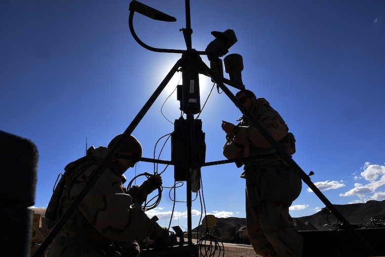Weather forecasters from the 3d Air Support Operations Group assemble a tactical meteorological observing system during a pre-deployment rotation at Ft. Irwin, California's National Training Center, Feb. 21, 2018. During their month-long NTC rotation, Air Force weather assets from various units within the 93d Air Ground Operations Wing advised, trained and assisted Army units to exploit weather and environmental conditions as they battled mock adversaries. As the Army's sole weather support asset, the training maximized integration in a hostile environment to enhance interoperability and assure mission success. (U.S. Air Force photo Senior Airman Greg Nash)