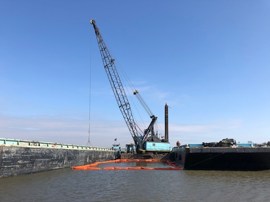 A dredge excavates material from the North Cove Federal Navigation project in Old Saybrook, Connecticut.
