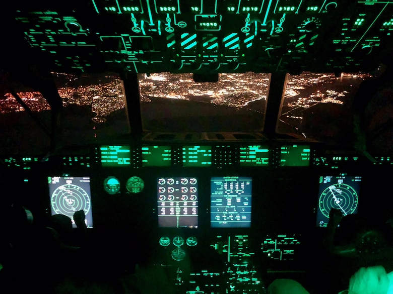 Pilots from the 53rd Weather Reconnaissance Squadron fly a WC-130J Super Hercules aircraft over San Diego, California during a mission to collect data from atmospheric rivers over the Pacific Ocean Jan. 28, 2018. (U.S. Air Force Courtesy photo)