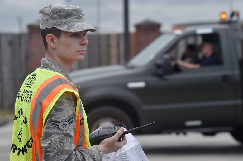 Airman 1st Class Tyler Connolly, 437th Aerial Port Squadron traffic management operations technician, checks equipment during a simulated cargo inspection at a cargo deployment function as part of mobility exercise Bold Eagle Feb. 26, at Joint Base Charleston, S.C.