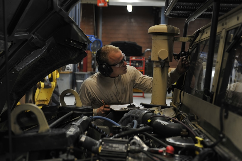 Senior Airman Braxton Willoughby, 628th Logistics Readiness Squadron vehicle maintenance journeyman, completes a vehicle check as part of mobility exercise Bold Eagle Feb. 26, 2018, at Joint Base Charleston, S.C.