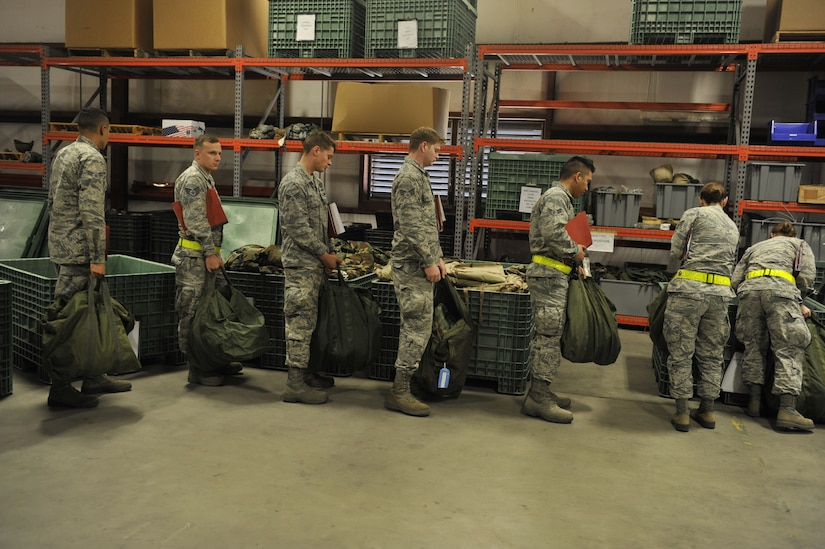 Airmen participating in mobility exercise Bold Eagle are issued individual personal protection equipment Feb. 27, 2018, at Joint Base Charleston, S.C.