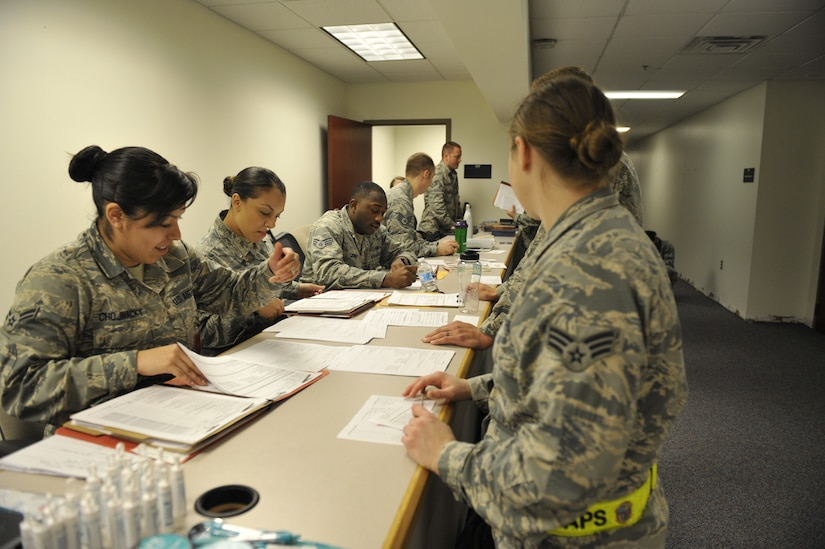 Airmen participating in readiness exercise Bold Eagle simulate a deployment process with various base agencies Feb. 27, 2018, at Joint Base Charleston, S.C.