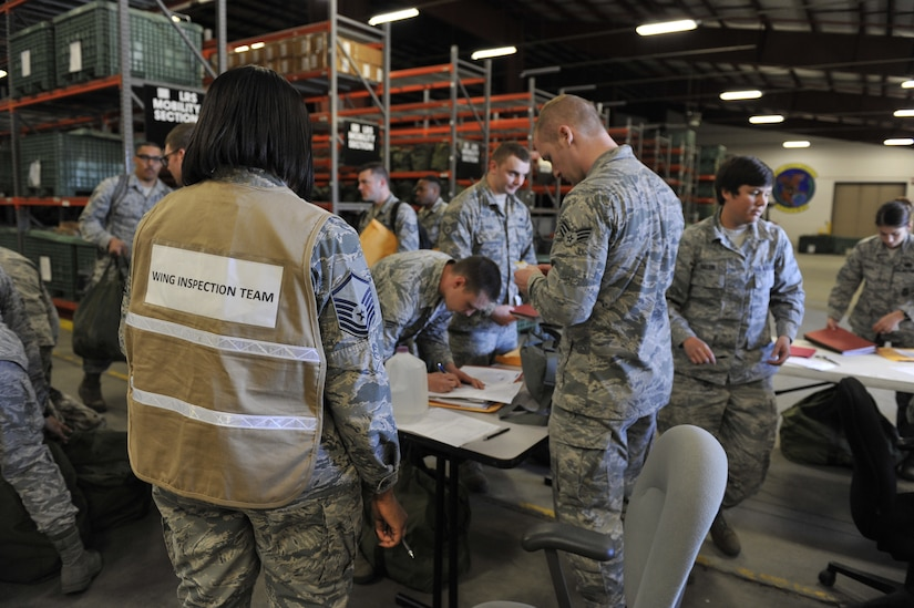 Members of the 628th Logistics Readiness Squadron oversee Airmen processing for a simulated deployment as part of mobility exercise Bold Eagle Feb. 27, 2018, at Joint Base Charleston, S.C. The first phase of the readiness exercise tested Airmen in their ability to deploy quickly and efficiently.