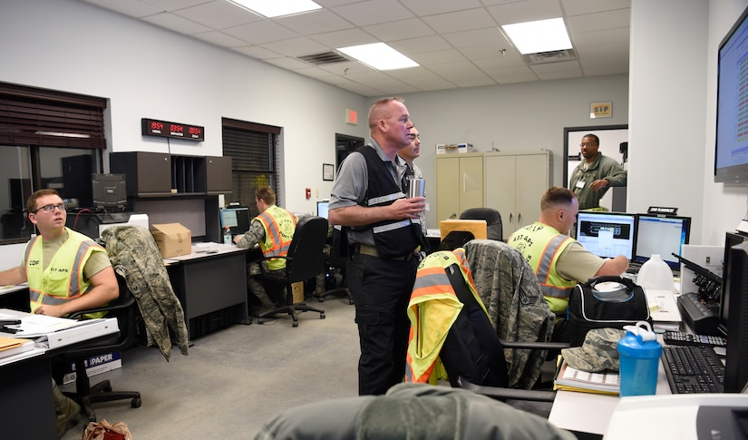 Members of the 437th Aerial Port Squadron air transportation flight, observe the postings for incoming and outgoing cargo at a cargo deployment function as part of readiness exercise Bold Eagle Feb. 26, at Joint Base Charleston, S.C.