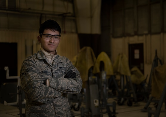 U.S. Airman 1st Class Alejandro Castillo, 33rd Maintenance Squadron aersospace ground equipment journeyman, stand in front of A.G.E. equipment Jan. 18, 2018, at Eglin Air Force Base, Fla. Castillo began playing soccer in highschool. As he progressed through the game he was eventually scouted by a proffesional team but injured himself. When he arrived at Eglin Air Force Base, he channeled his passion for the sport into coaching a childrens soccer team. (U.S. Air Force photo by Staff Sgt. Peter Thompson/Released)