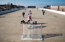 PETERSON AIR FORCE BASE, Colo. – Canadians and Americans compete in the annual USA vs. Canada Ball Hockey Game at Peterson Air Force Base, Colo., Feb. 23, 2018. Service members and civilians from North American Aerospace Defense Command, Air Force Space Command, Cheyenne Mountain Air Force Station and Peterson AFB, Colo., participated in the game. The Americans defeated the Canadians 3-2. (U.S. Air Force photo by Senior Airman Dennis Hoffman)