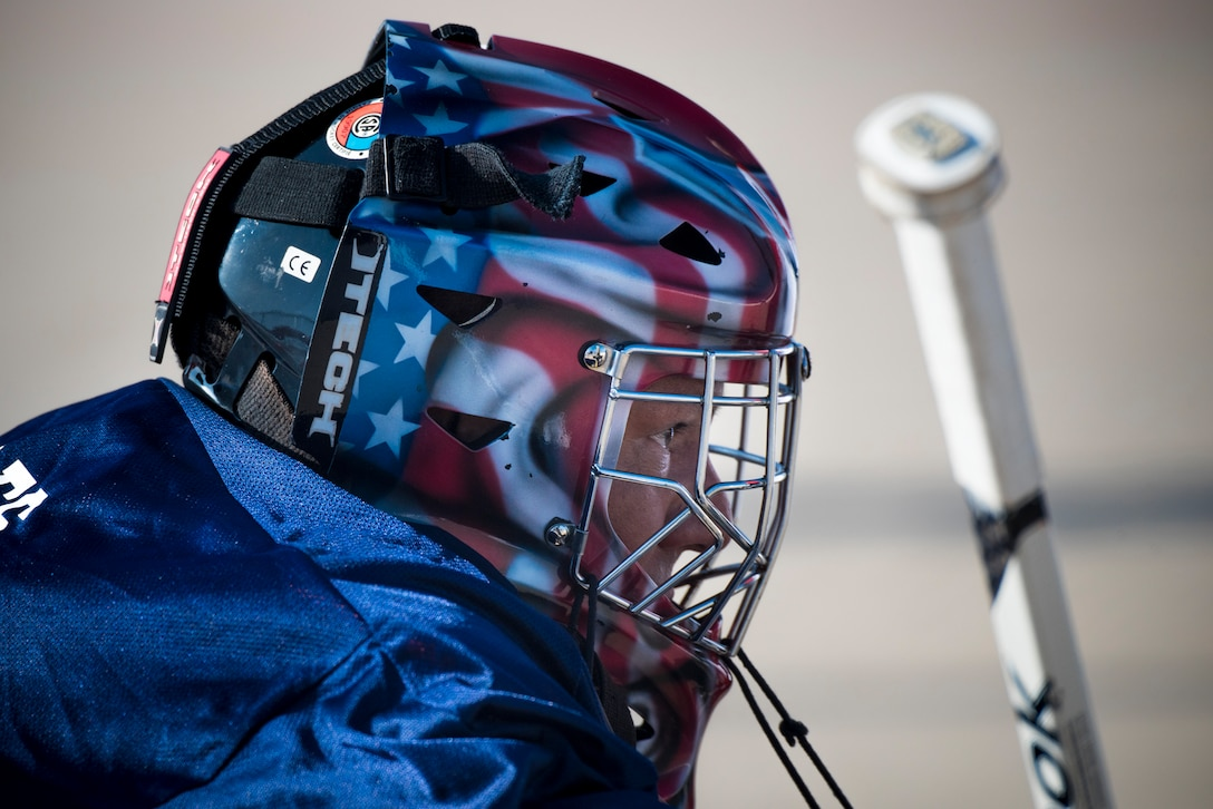 PETERSON AIR FORCE BASE, Colo. – Lt. Col. Miguel Rosales, 21st Plans and Programs commander, guards the net as the goalkeeper for the American team during the annual USA vs. Canada Ball Hockey Game at Peterson Air Force Base, Colo., Feb. 23, 2018. The Americans defeated the Canadians 3-2. (U.S. Air Force photo by Senior Airman Dennis Hoffman)