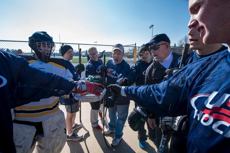 PETERSON AIR FORCE BASE, Colo. –Team U.S. comes together to rally in between the first and second period during the annual USA vs. Canada Ball Hockey Game at Peterson Air Force Base, Colo., Feb. 23, 2018. After three periods of non-stop action, the Americans were victorious with the final score being 3-2. (U.S. Air Force photo by Senior Airman Dennis Hoffman)