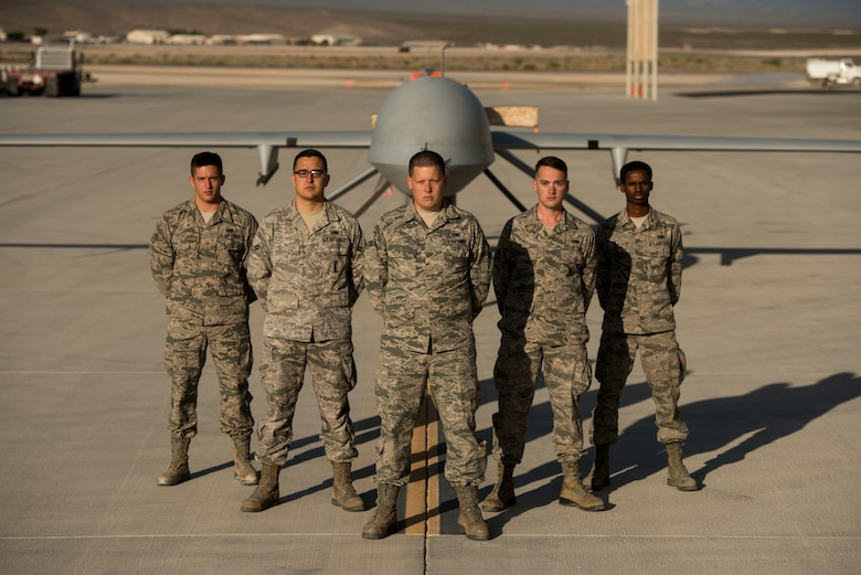 432nd Aircraft Maintenance Squadron maintainers stand in front of an MQ-1 Predator May, 5, 2015, at Creech 