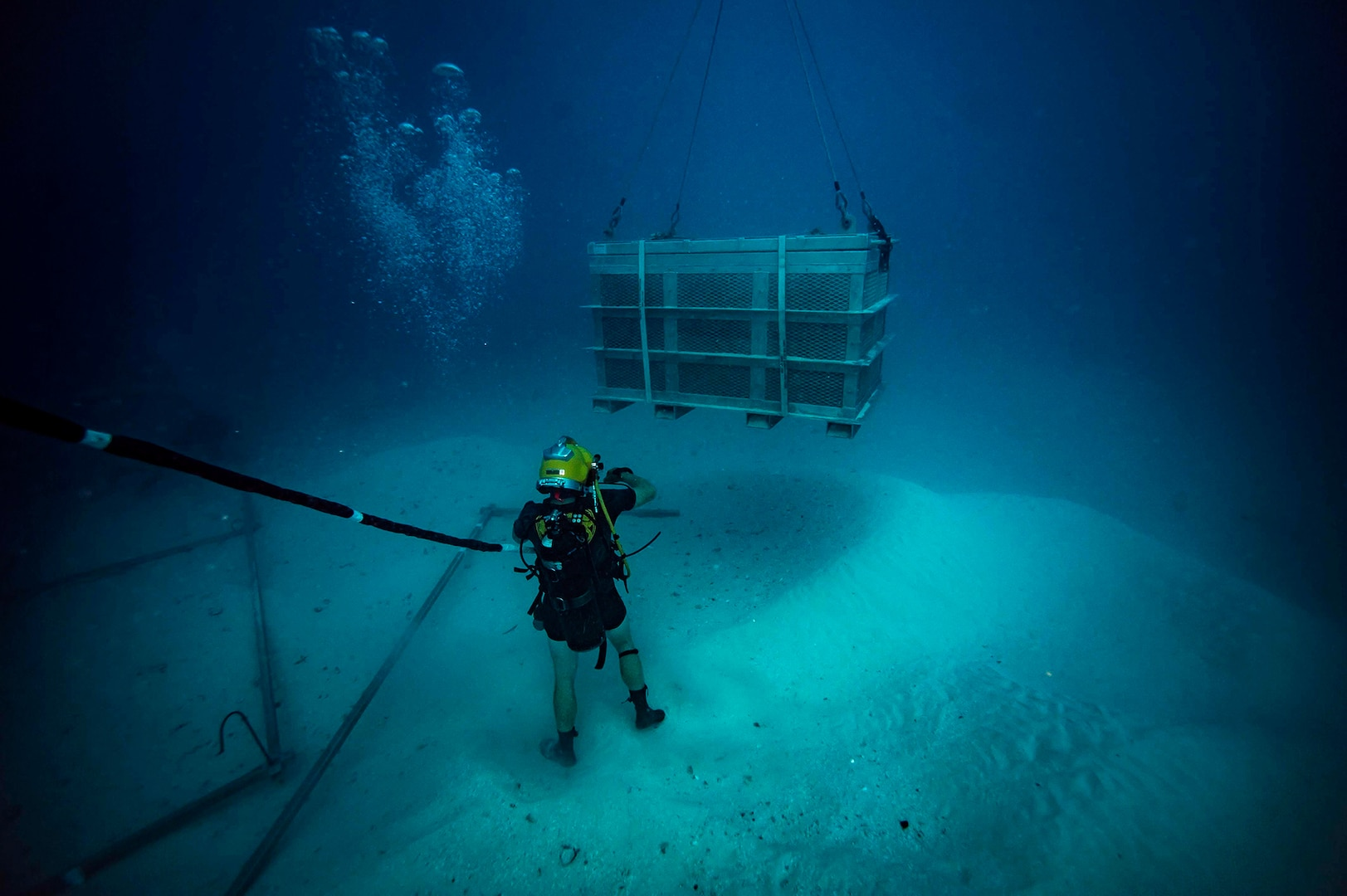 USNS Salvor, MDSU Divers Team Up with DPAA to Recover WWII Pilot's Remains Near Palau
