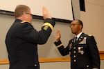 DLA Troop Support Commander Army Brig. Gen. Mark Simerly, left, administers the Army oath of office for newly promoted Chief Warrant Officer Five Timothy Hagans, during a ceremony in Hagans' honor Feb. 23, 2018 in Philadelphia. Hagans served as a military food advisor within DLA Troop Support's Subsistence supply chain for the last four years.