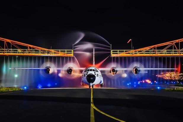 Image of a U.S. Coast Guard HC-130 aircraft rinse down